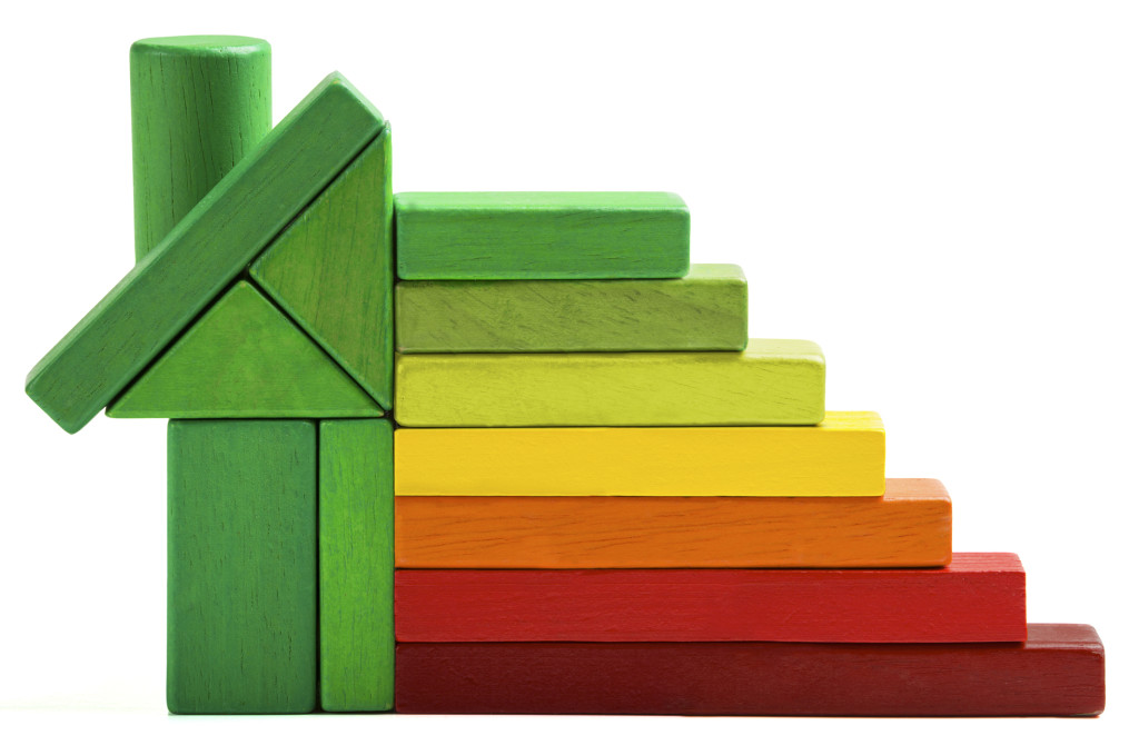 house energy efficiency rating, green home save heat and ecology. Toy blocks isolated white background
